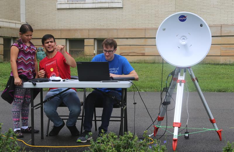 Pitt students Carlos Vasquez (left) and Marshall Hartman monitor the balloon's satellite tracking system and coding ahead of the team's practice launch of Friday, July 14, 2017.