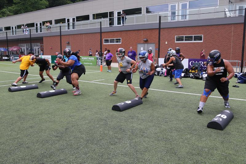 The Women's Football Alliance All-American National team offensive lines practices under the direction of Pittsburgh Passion offensive line coach Adam Santoro on Friday, July 21, 2017.