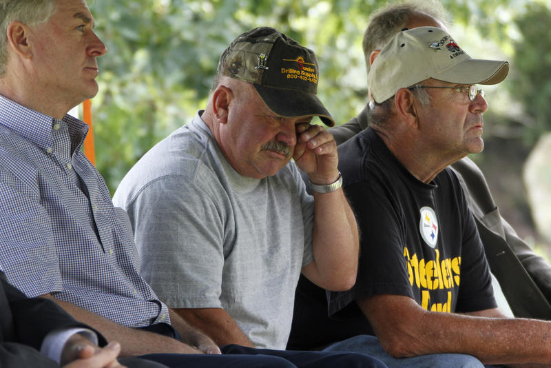 Former Pennsylvania governor Mark Schweiker, left, sits with former coal miners Thomas Foy, center, and John Unger, who were two of nine miners rescued from Quecreek in 2002.