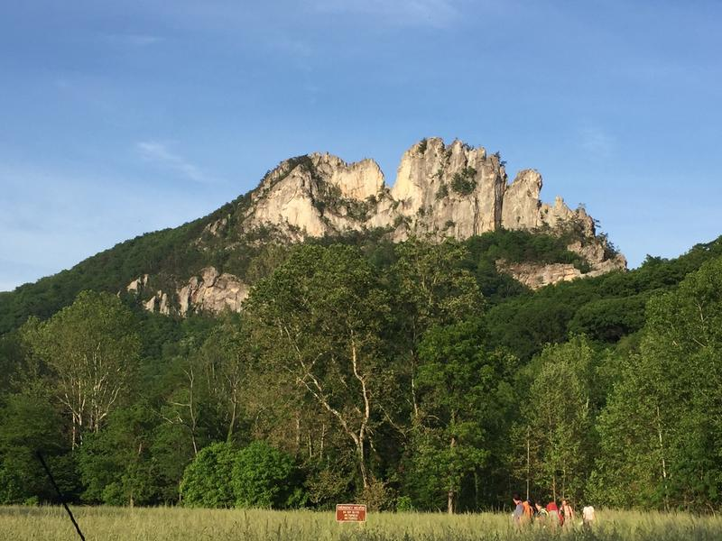 Five acres of the lower slabs area of Seneca Rocks' North Peak (left) sustained fire damage after officials say fireworks were set late in the evening Saturday, July 1, 2017.