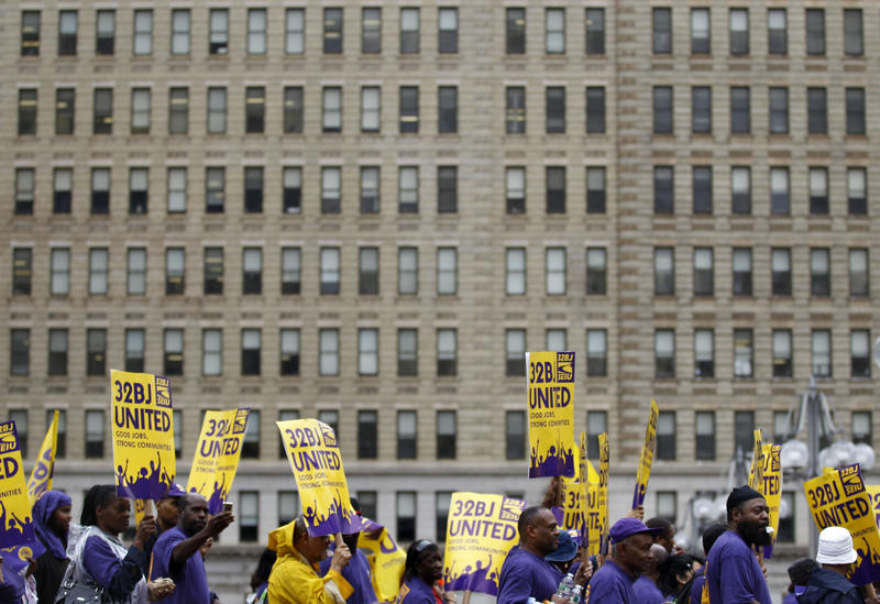 Members of the Service Employees International Union protest on Wednesday, Sept. 28, 2011, in Philadelphia.