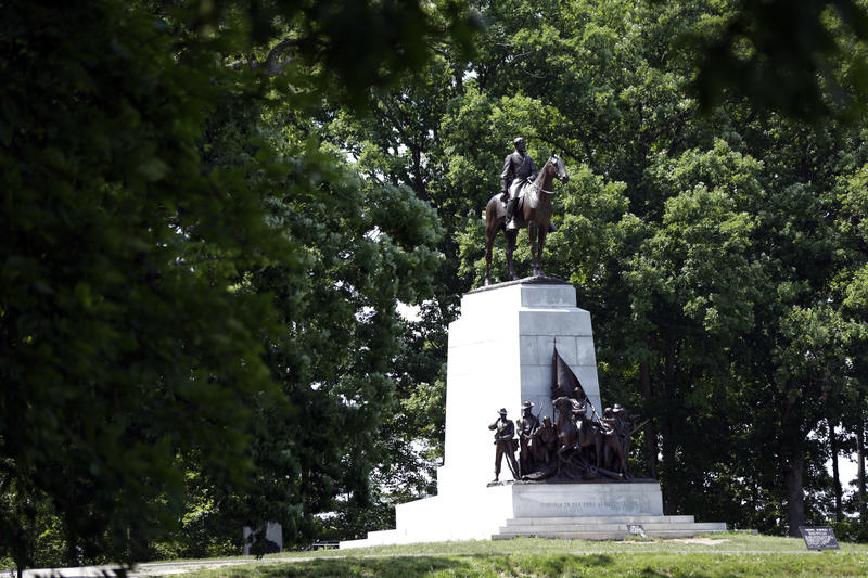 A monument to General Robert E. Lee mounted on his horse Traveller sits atop a ridge held by Confederate troops, above the field of Pickett's Charge, Wednesday, June 5, 2013 in Gettysburgh, Pa.