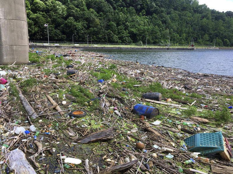 A raft of garbage and debris stretches across the Monongahela River at the dam and spillway in Fairmont, W.Va., on June 21, 2017. Regulators say the plant responsible for converting the dirty water into drinking water far exceeds federal standards.