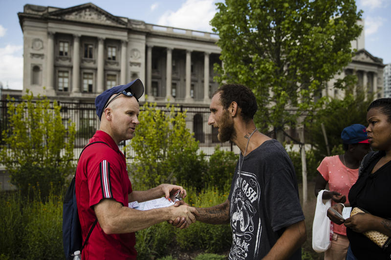 Adam Bruckner with Philly Restart, left, helps Steven Kemp, who is addicted to heroin and is homeless, to obtain an identification card in Philadelphia on Monday, July 24, 2017. Kemp struggles to get treatment without proper ID.
