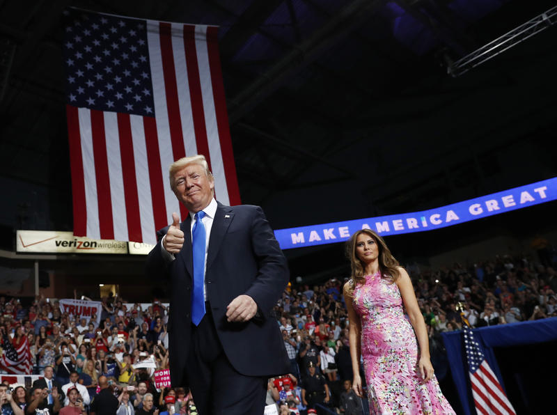 President Donald Trump and First Lady Melania Trump arrive for a rally, Tuesday, July 25, 2017, at the Covelli Centre in Youngstown, Ohio.