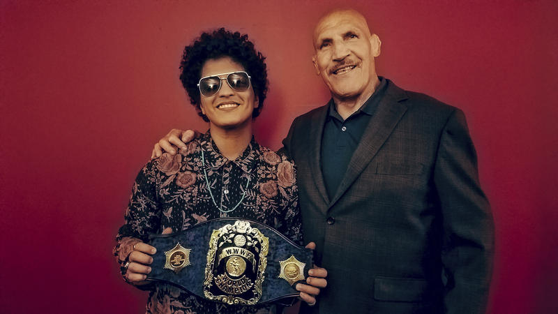This Tuesday, Aug. 22, 2017, photo provided by Shaun Hoffman, shows Bruno Marks, left, meeting retired professional wrestler Bruno Sammartino, right, as Mars holds Sammartino's world champion belt.