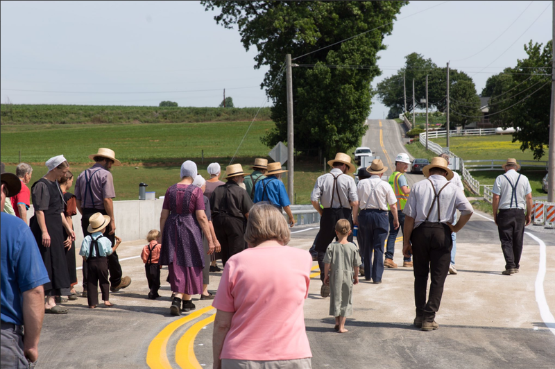 Residents walk across a newly reopened bridge in Caernarvon Township in Lancaster County. The bridge is one of 558 being replaced through the Rapid Bridge Replacement Project.