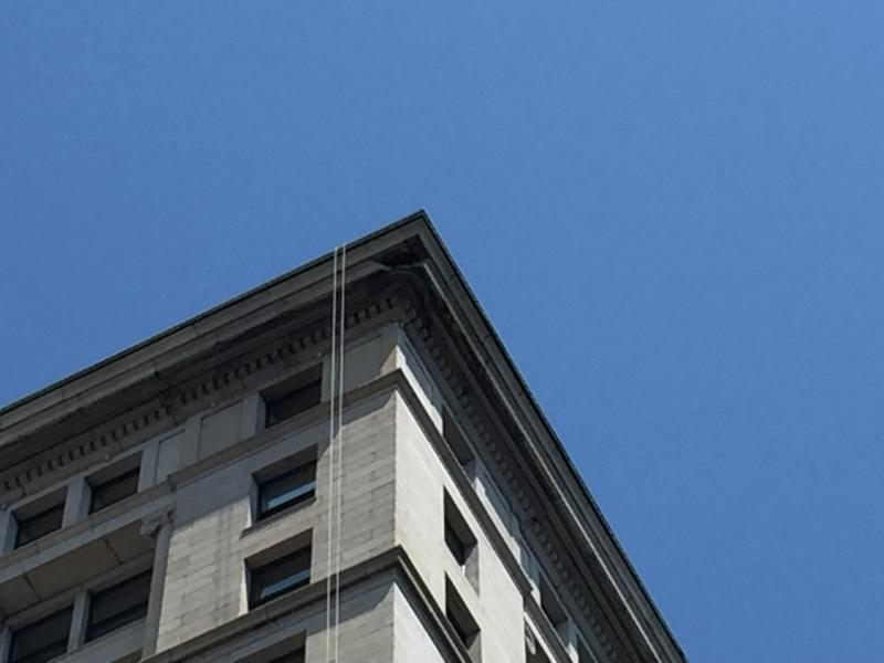 A 1,300-pound piece of granite broke off the top cornice of the Frick Building in Downtown Pittsburgh on Sunday.