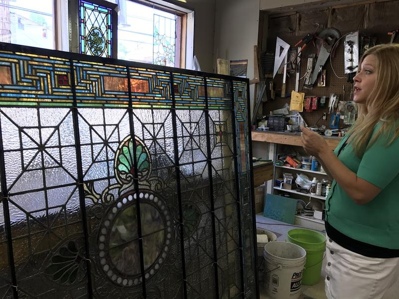Williams Stained Glass Studio Manager and Designer Keeley Hancox describes the process of cleaning and repairing the large stained glass panels.