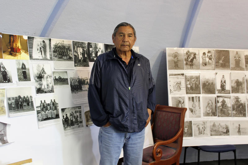 In this May 6, 2016, file photo, Russell Eagle Bear, the historic preservation officer for the Rosebud Sioux Tribe stands in his office. He partnered with the U.S. Army to uncover the boys' remains at the Carlisle Indian school.