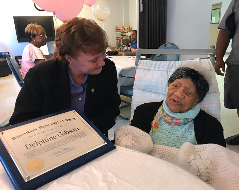 Pennsylvania Secretary of Aging Teresa Osbourne and Delphine Gibson, the oldest living person in the United States.
