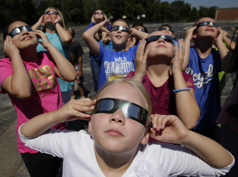 In this photo taken Friday, Aug. 18, 2017, fourth graders at Clardy Elementary School in Kansas City, Mo. practice using their eclipse glasses. Pennsylvania Attorney General Josh Shapiro Monday issued a warning that people only use NASA-endorsed glasses.