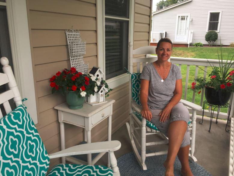 Export Council vice president Melanie Litz sits on her porch at her home in Export, Pa.