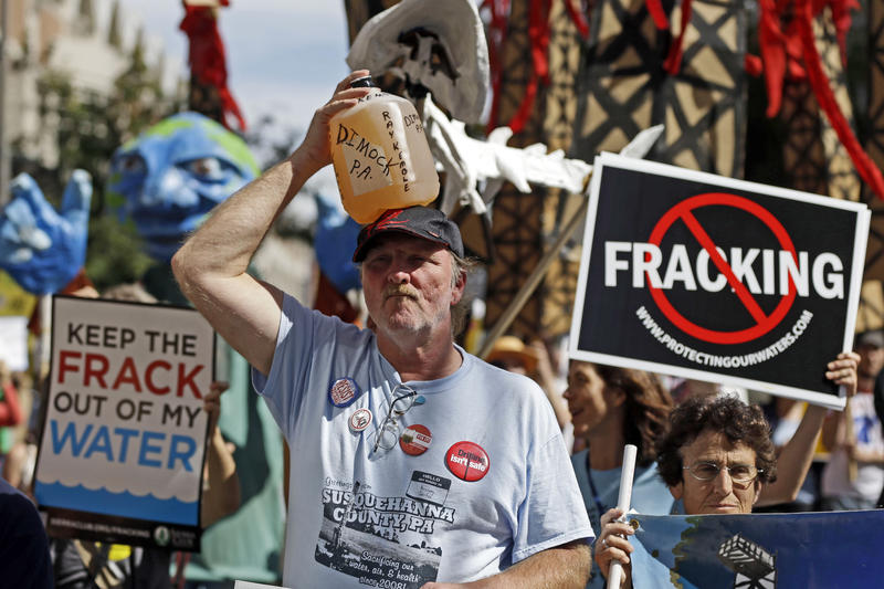In this Sept. 20, 2012, file photo, Ray Kemble, of Dimock, Pa., holds holds a jug on his head while demonstrating with protesters against hydraulic fracturing outside a Marcellus shale industry conference in Philadelphia.