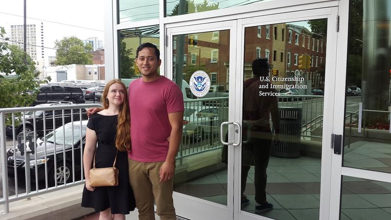 Lillie Williams and Jonatan Palacios stand outside of the offices of U.S. Citizenship and Immigration Services in West Philadelphia after completing an interview to determine the legitimacy of their marriage.