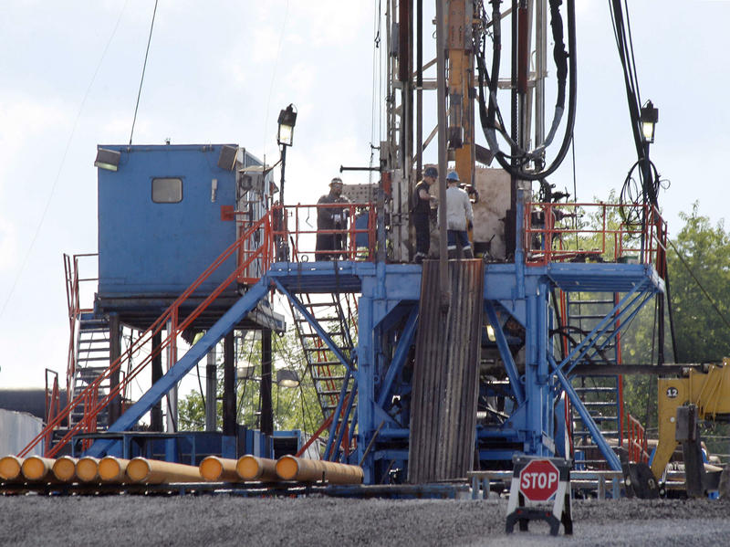 Crews work at a natural gas drilling site in Zelienople, Pa.