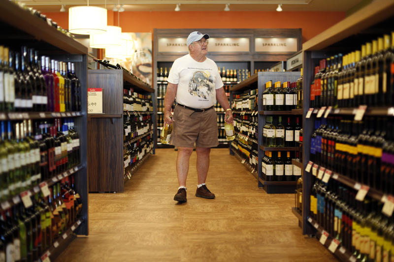 In this Thursday, July 22, 2010 photo, Jay Petrie of Solebury, Pa.,  shops at a newly opened state wine and liquor store.