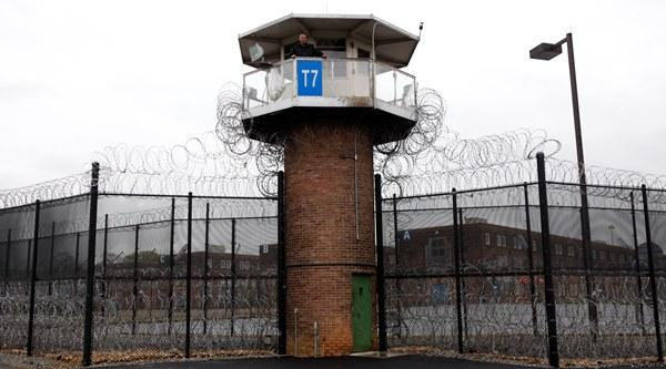 In this Tuesday, April 13, 2010 photo, a solitary corrections officer looks out from a tower at one corner of the state prison in Camp Hill, Pa.