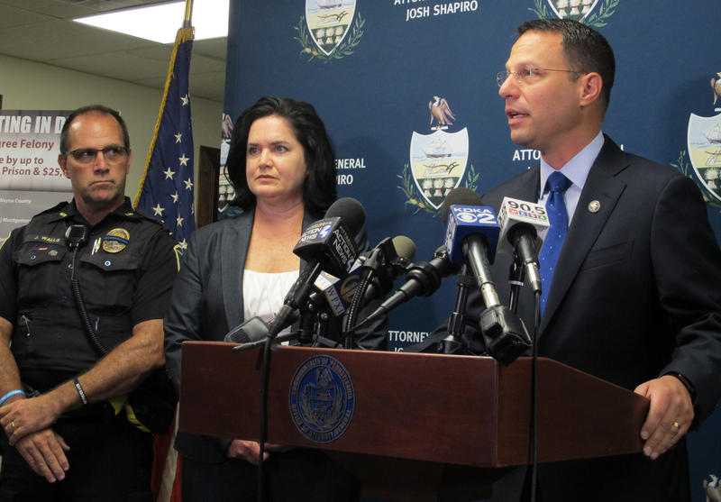 Pennsylvania Attorney General Josh Shapiro (right) speaks at a press conference at the North Fayette Police Department on Thursday, August 10, 2017. From R-L: Shapiro, Senior Deputy Attorney General Marnie Sheehan-Balchon and NFPD Lt. John Walls.