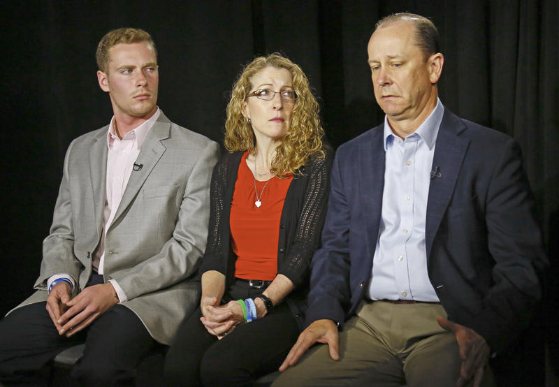 In this May 15, 2017, file photo, James Piazza, right, seated with his wife Evelyn, center, and son Michael, left, holds back emotions while discussing the death of his son Tim.