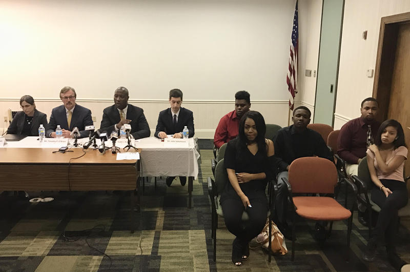 Five former Woodland Hills School District students sit next to their attorneys at a press conference Wednesday downtown. The students are suing the district.