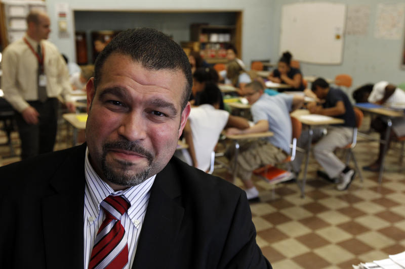Pennsylvania Department of Education Secretary Pedro Rivera with students at Lincoln Middle School in 2011. The state must create a plan to comply with the Every Student Succeeds Act, but low-performing schools continue to struggle.
