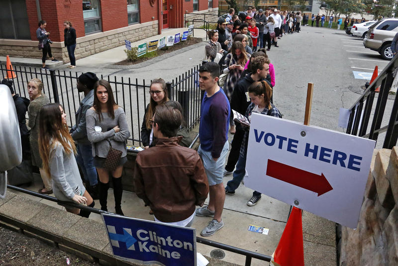 Students from Duquesne University wait in line to cast their votes outside Epiphany Catholic Church in Pittsburgh, Tuesday, Nov. 8, 2017.
