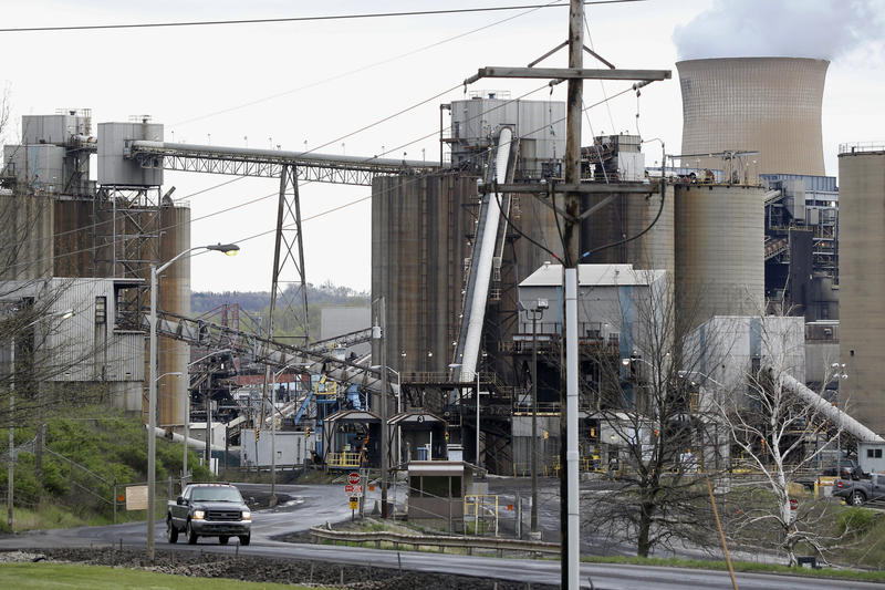 A pickup truck drives down a road of the Home City Generating Station in Homer City, Pa. on May 5, 2014. Maryland's attorney general is suing the Environmental Protection Agency for failing to act on air pollution from five upwind states.