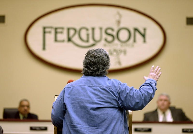 Gerry Jasper speaks in favor of an agreement with the U.S. Department of Justice during a city council meeting Tuesday, Feb. 2, 2016, in Ferguson, Mo. The agreement included overhauling police policies following the fatal police shooting of Michael Brown.