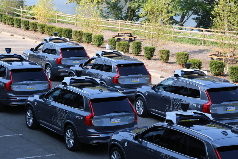 A fleet of self-driving vehicles are lined up outside of Uber's Advanced Technologies Center in the Strip Distrcit on Wednesday, Sept. 20, 2017.