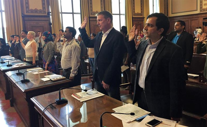 Eighteen new U.S. citizens being sworn in at a naturalization ceremony at the City-County Building on Friday, Sept. 22, 2017.