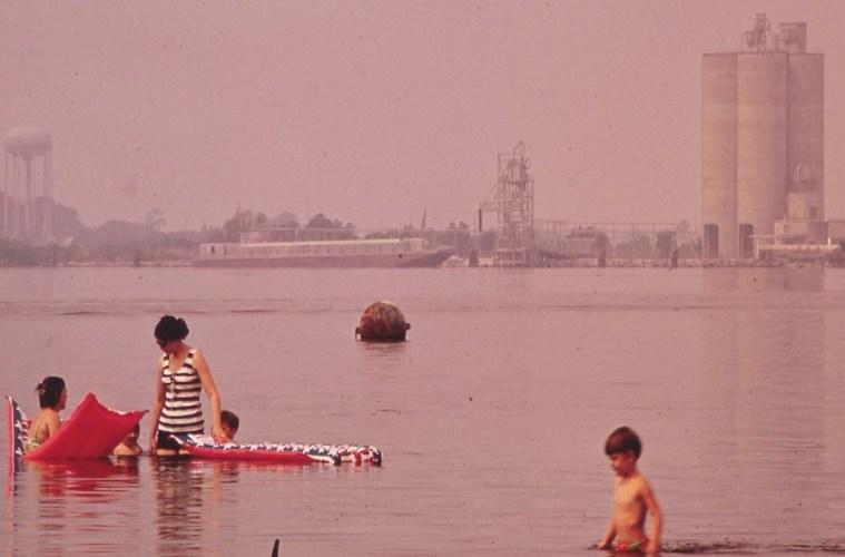 Swimming in polluted Lake Charles. Olin-Mathieson Plant in background in June of 1972.