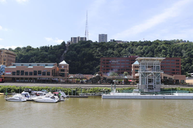 The docks and shops of Station Square can be seen from the Monongahela River in Pittsburgh, Wednesday, July 26, 2017.