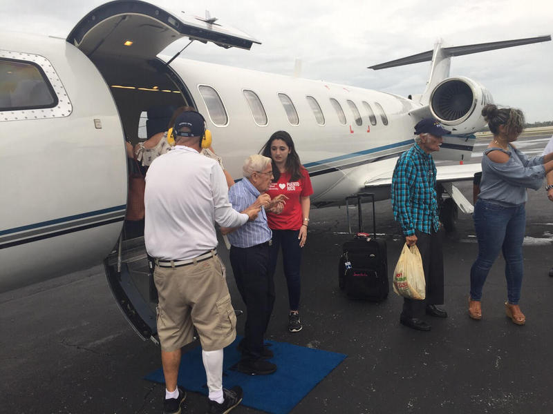 Rosana Guernica helps Puerto Rico evacuees off of a private charter plane she paid for through crowdfunding.