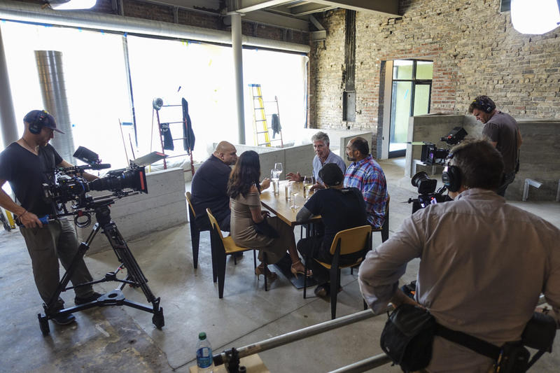 Celebrity chef Anthony Bordain speaks with former Steelers fullback Franco Harris, Braddock Mayor John Fetterman and his wife Gisele Fetterman, cofounder of 412 Food Rescue, during the filming of Parts Unknown for CNN.