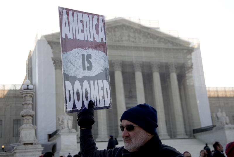 Fred Phelps Jr., of Topeka, Kansas, with the Westboro Baptist Church holds a sign in front of the Supreme Court in Washington, Wednesday, March 27, 2013. The Kansas-based church says they'll be protesting at various locations in Pittsburgh on Thursday.