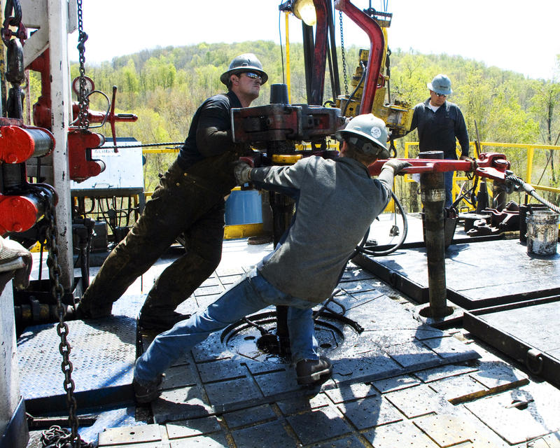 In this April 23, 2010 photo, workers move a section of well casing into place at a Chesapeake Energy natural gas well site near Burlington, Pa., in Bradford County. A new study suggests industry employers and training programs aren't collaborating.