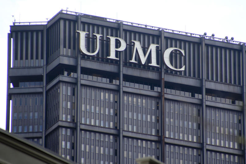 The signs marking the offices for the University of Pittsburgh Medical Center, UPMC, are seen on top of the U.S. Steel tower on Monday, April 3, 2017, in Pittsburgh.