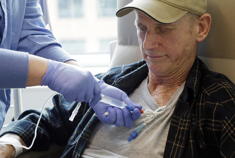 In this photo taken March 21, 2017, lymphoma patient Peter Bjazevich receives cellular immunotherapy as part of a study at the Fred Hutchinson Cancer Research Center in Seattle.