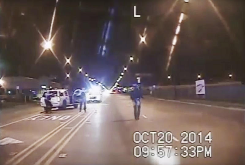 Dash-cam video shows teenager Laquan McDonald (right) walking down the street moments before Chicago police officer Jason Van Dyke fatally shot him. Three officers were later indicted on felony charges alleging they conspired to cover up the shooting.