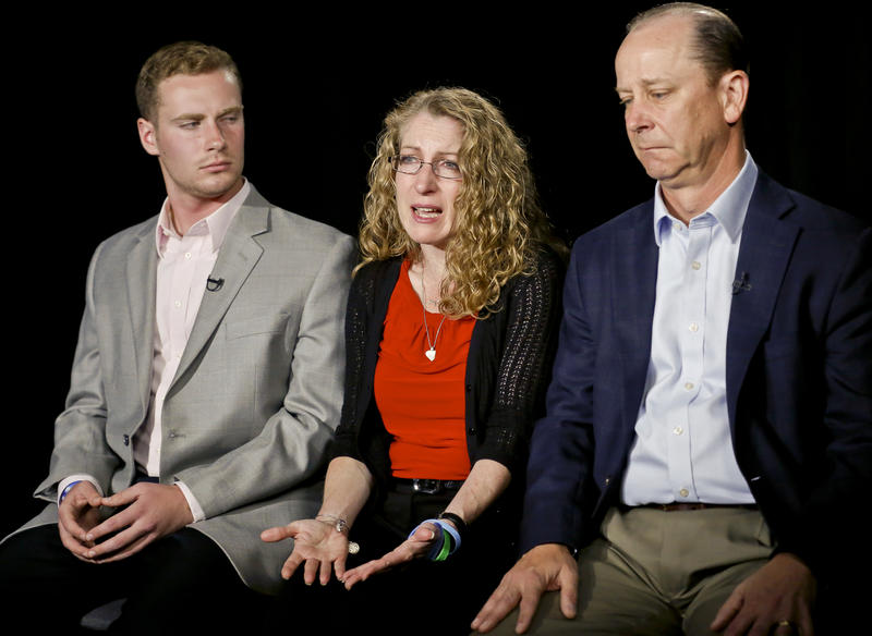 In this May 15, 2017, file photo, Evelyn Piazza, center, seated with her husband James, right, and son Michael, left, speaks during an interview in New York about her son, Timothy, who died during a fraternity house drinking ritual at Penn State.
