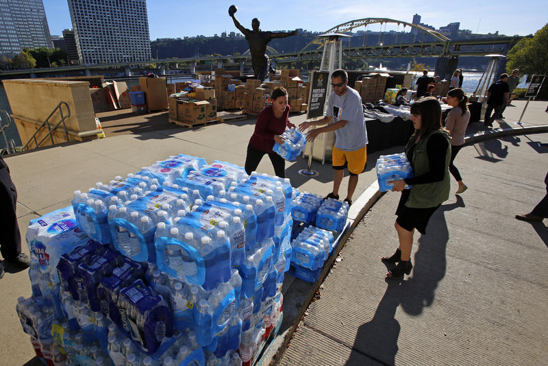 Baseball Hall of Famer Roberto Clemente's team, the Pittsburgh Pirates, collect donations outside PNC Park in Pittsburgh for hurricane-devestated Puerto Rico Monday, Oct. 2, 2017.