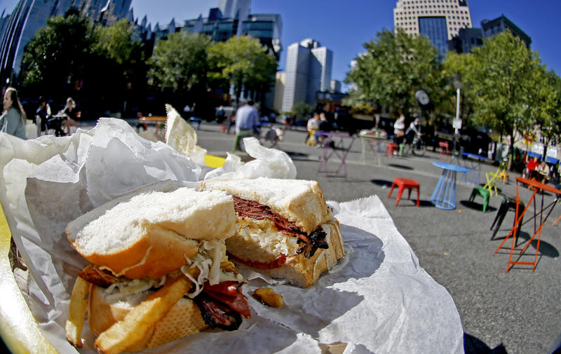 A Primanti Bros. sandwich with pastrami, french fries and cole slaw is sliced open on a table in Market Square in Downtown Pittsburgh Wednesday, Oct. 18, 2017. The restaurant offered a lifetime 15 percent discount to Amazon employees if HQ2 comes to town.