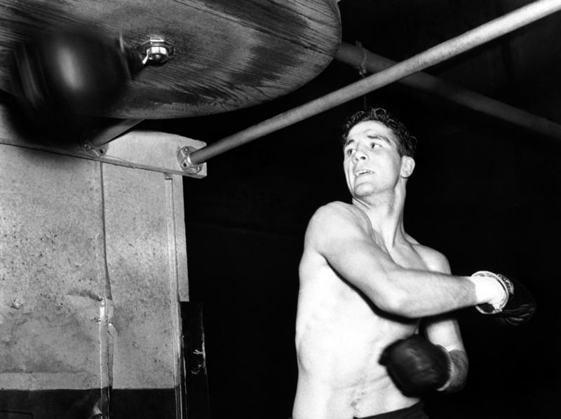 American Light-Heavyweight Billy Conn, of Pittsburgh, takes a whack at the punching bag in New York on Feb. 7, 1939, as he prepared for a fight against Fred Apostoli, in Manhattan February 10.