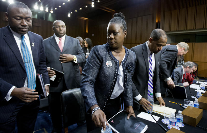 "Association of Prosecuting Attorneys President and CEO David LaBahn (bent, far right) testified with Sybrina Fulton, the mother of Trayvon Martin (center), for a Senate Judiciary Subcommittee on ""stand your ground laws"" on Capitol Hill on Oct. 29, 2013."