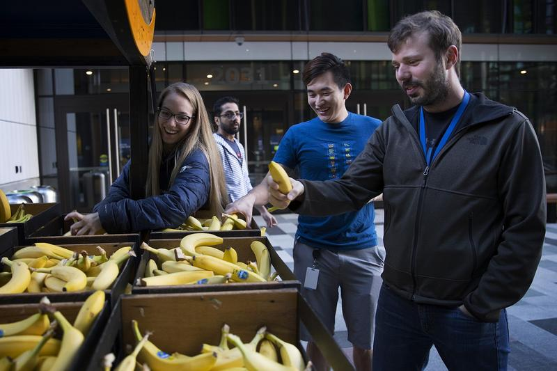 Amazon offers free bananas to Seattle employees and passers-by alike. But some say the company's presence has hiked up the cost of living in the city.