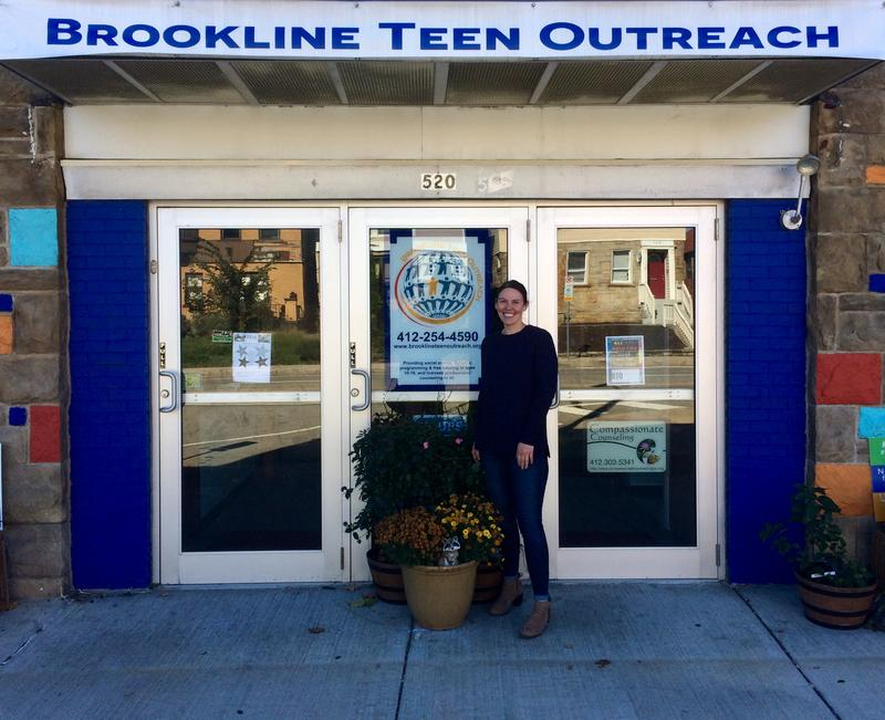 Caitlin McNulty stands outside the entrance of the Brookline Teen Outreach Center, the youth-focused nonprofit she co-founded in 2015.