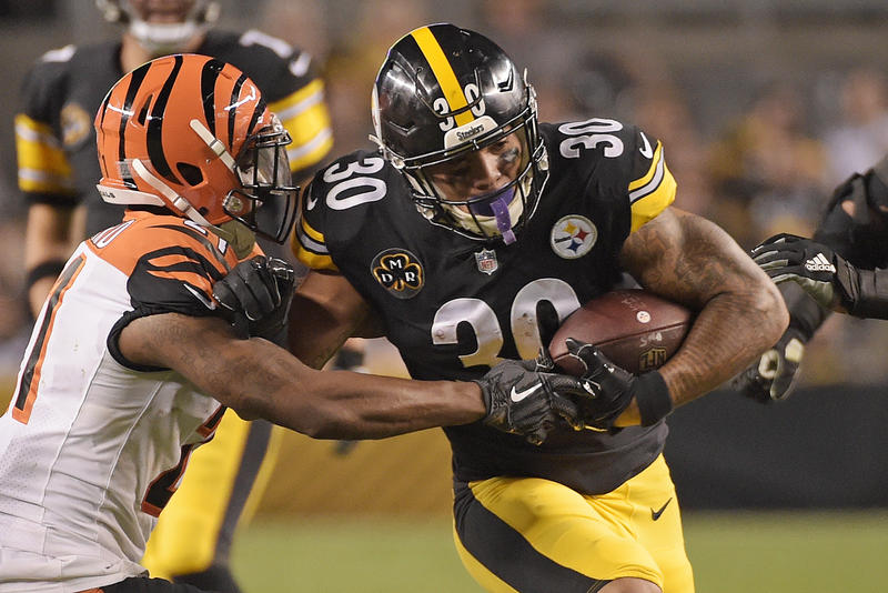 Pittsburgh Steelers Running Back James Conner is tackled by Cincinnati Bengals cornerback Darqueze Dennard on Sunday, October 22, 2017.