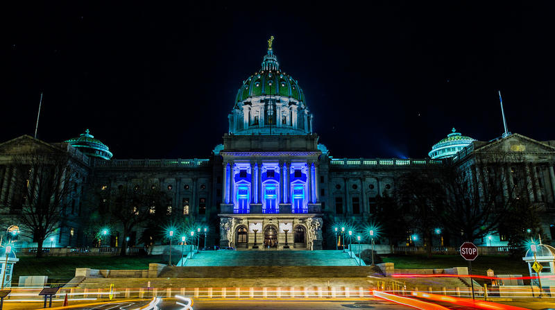 In this picture, the Capitol building is lit for Villanova University during the 2016 NCAA championships. Gov. Tom Wolf's office announced Monday that the building would be lit with blue, gold and green from the Nevada state flag in solidarity.