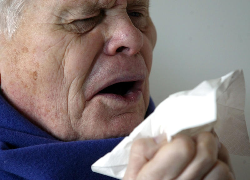 An elderly patient sneezes on January 14, 2005.